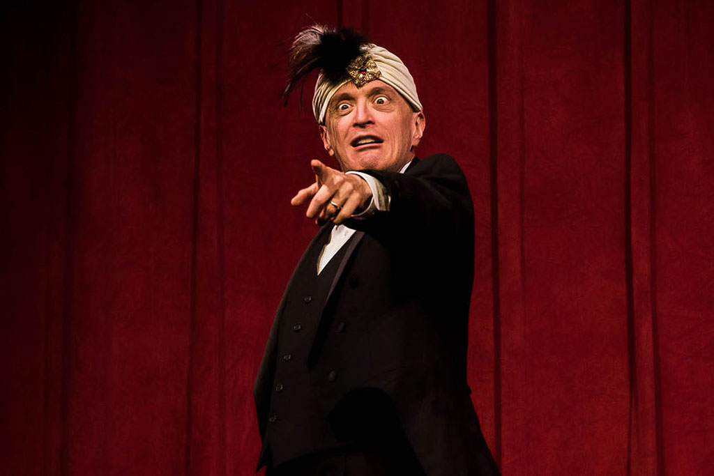 Photo from The 39 Steps (2016-17) - a performer points towards the audience